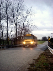 A school bus approaches a bridge
