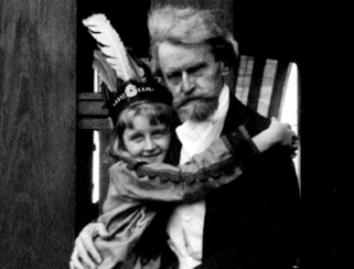 Huguette Clark as a child in Indian costume hugging her father W.A. Clark
