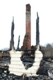 Image of chimney remaining after home burns