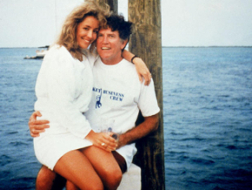 Senator Gary Hart on boat with friend Donna Rice on his lap