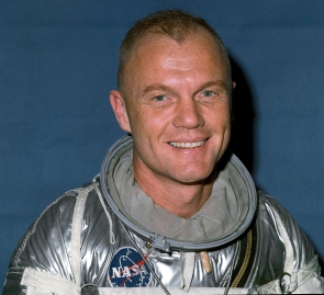Astronaut John Glenn in space suit smiling