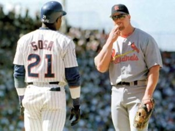 Baseball players Mark McGwire and Sammy Sosa greet each other on the field