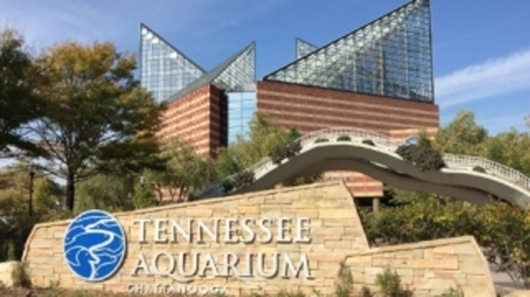 Outside view of Tennessee Aquarium brick building with two triangular spires